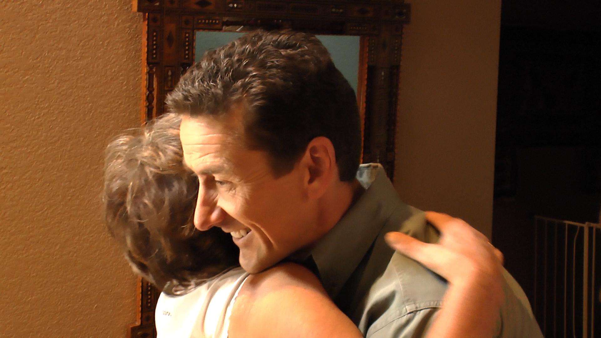 paul hugs client