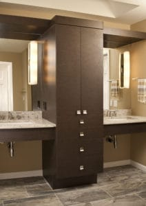 Dual sinks separated by custom cabinets.