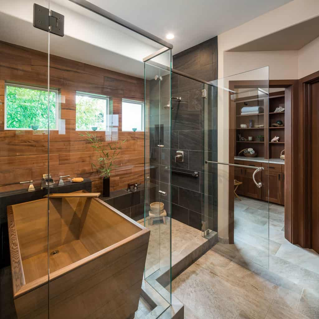 A wet room incorporates tub - in this case a gorgeous Japanese Ofuro tub - and shower in the same enclosure.