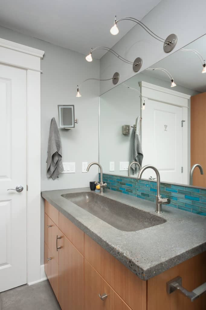 Thoughtful lighting design makes this bath comfy and healthy.