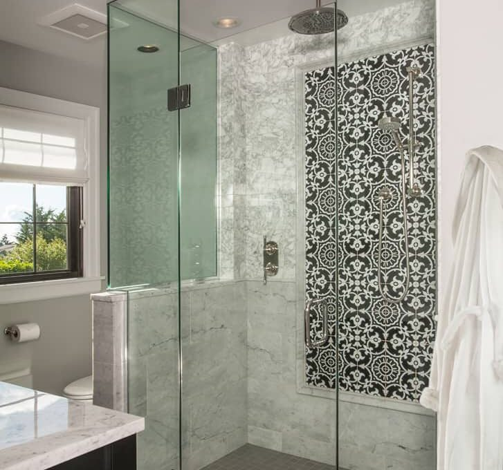 Modern Contemporary style bathroom remodel with frameless shower with rainshower head, and large floral tile design.