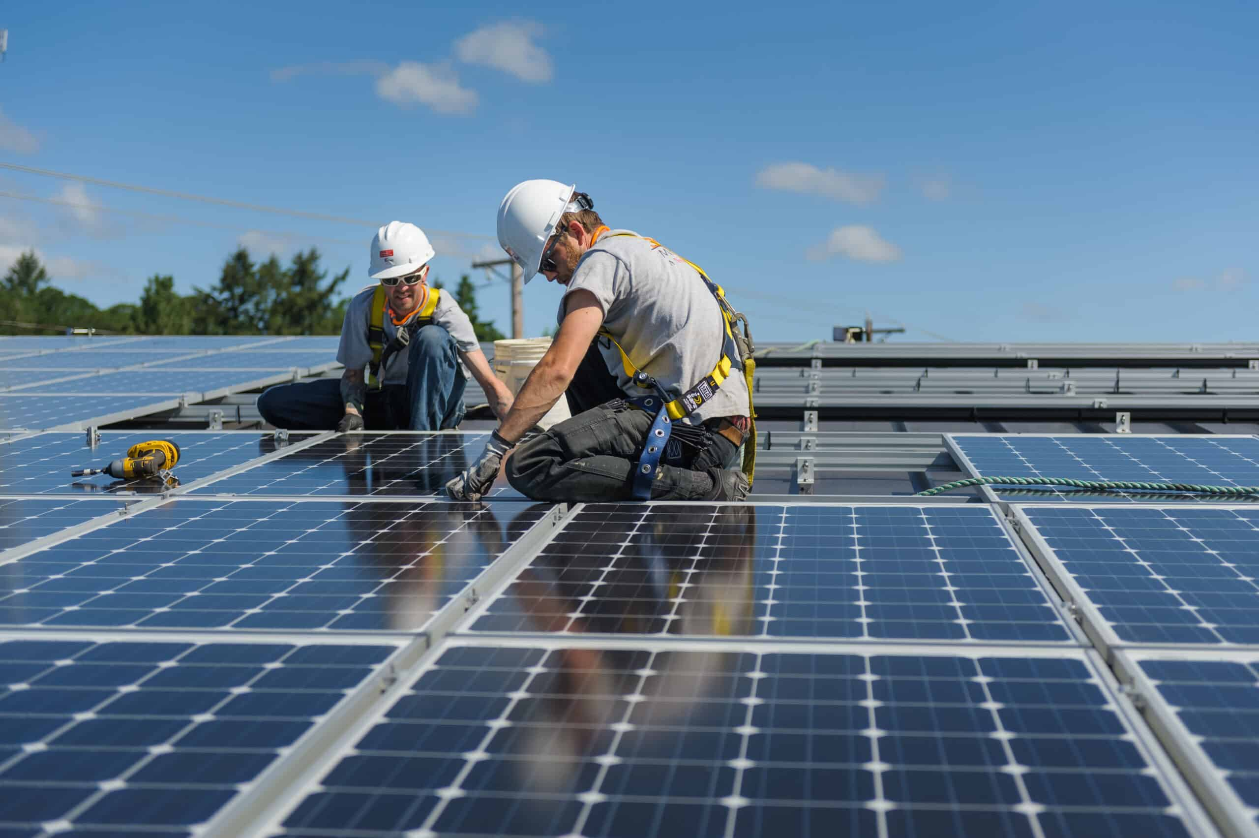 Neil Kelly installs solar panels at a Salem, Oregon rehabilitation center.