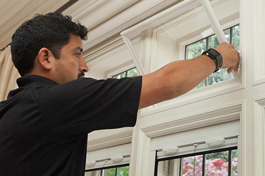 Certified professional checking windows in home for energy efficiency
