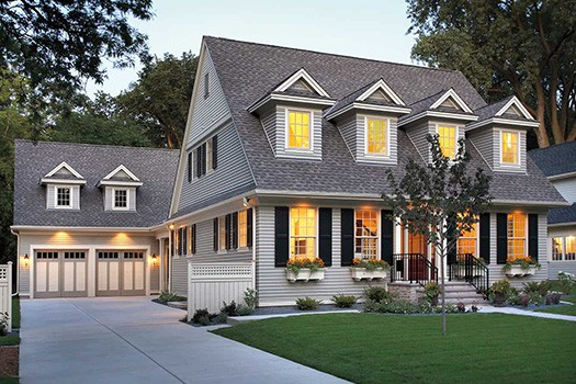 Alt tag: Two story home with 14 windows and two car garage