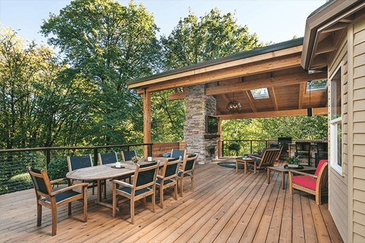 Expansive partially covered deck with dining and living space