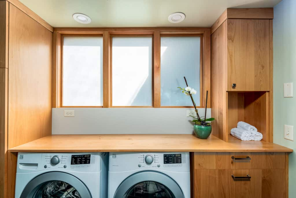 Bright laundry room with ample work space and storage