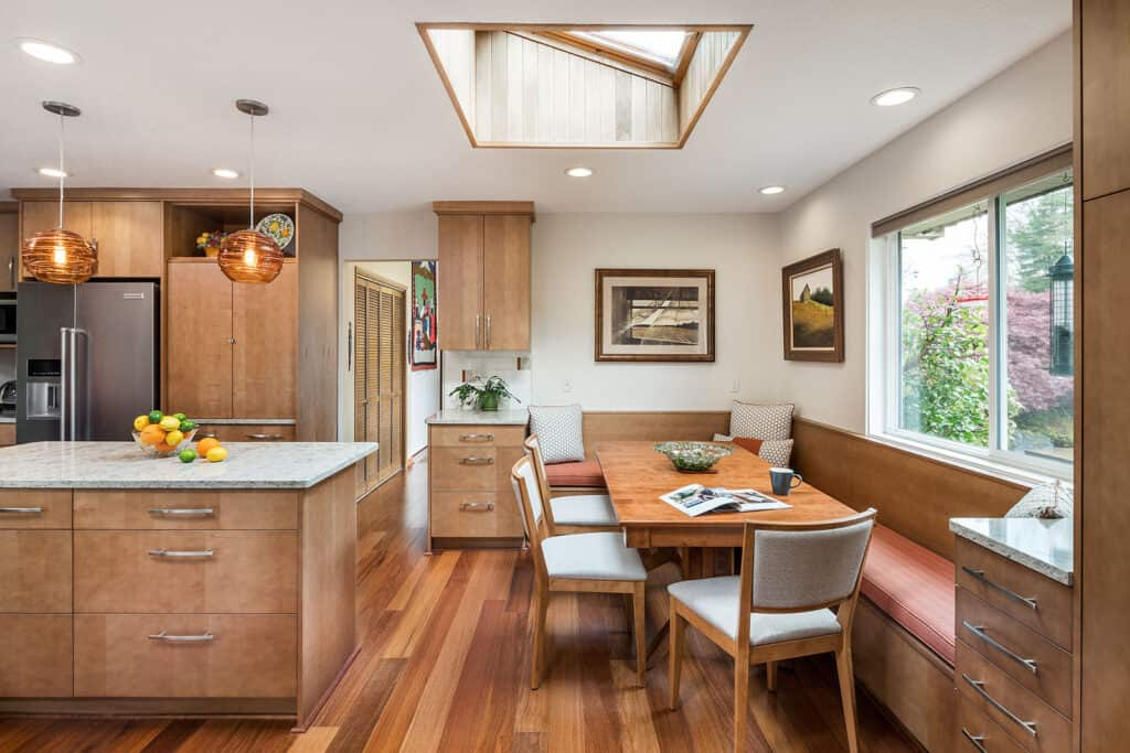 Kitchen with adjacent banquette adds multifunctional space.