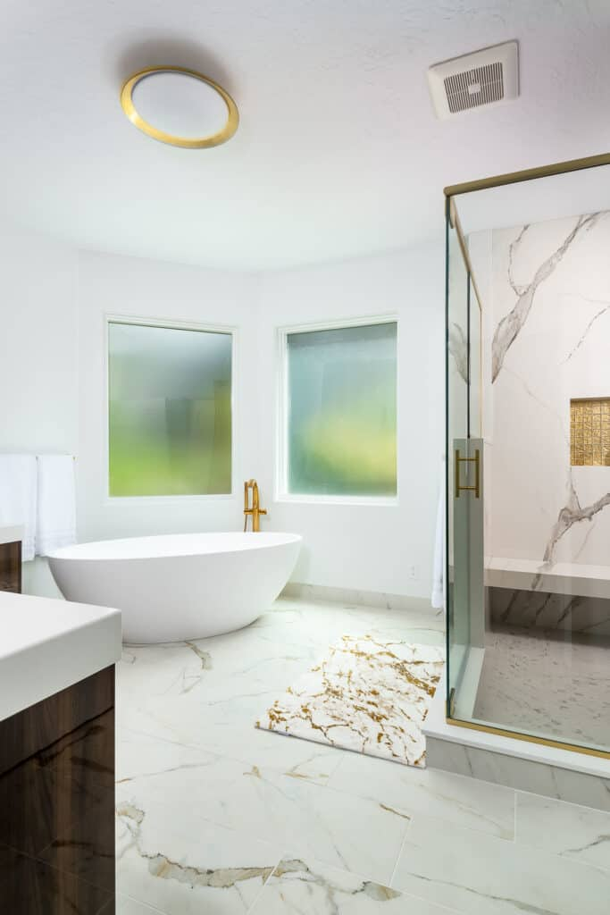 Open concept bathroom with freestanding tub and walk-in shower.