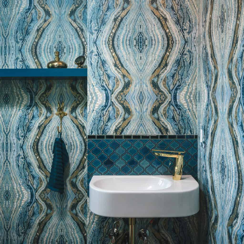 Printed wall paper makes a statement, especially in half-baths and powder rooms.