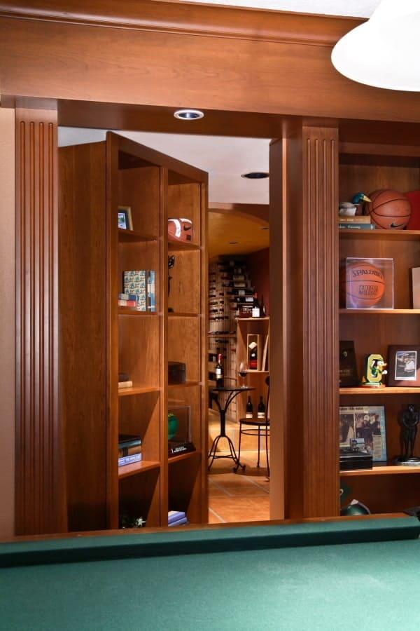 Secret bookshelf door entrance to wine cellar