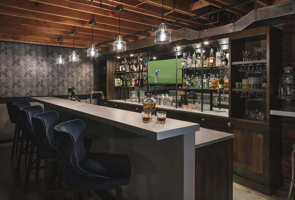 Basement man cave with full bar and television
