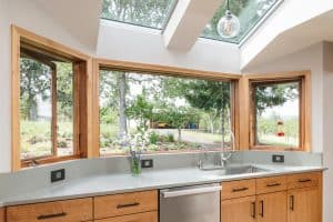 kitchen design with big windows and skylights